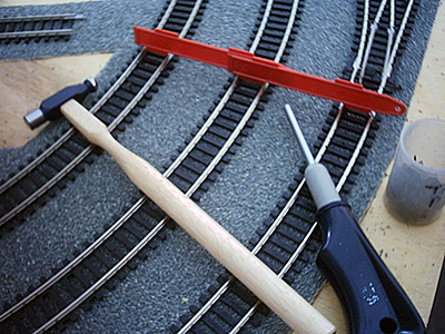 Track laying accessories: hammer, track guage, nails